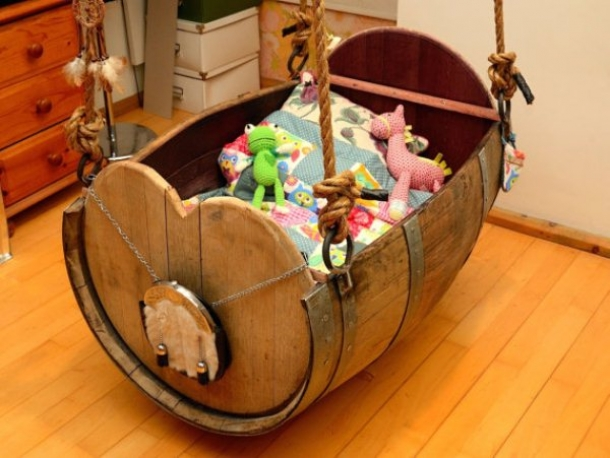 baby crib made out of whiskey barrel